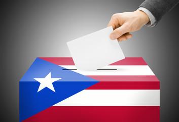 Ballot box painted into national flag colors - Puerto Rico