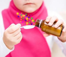 Hands holding medicine health care syrup