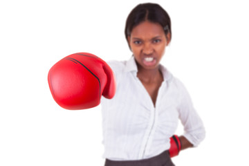 Young black woman wearing boxing gloves