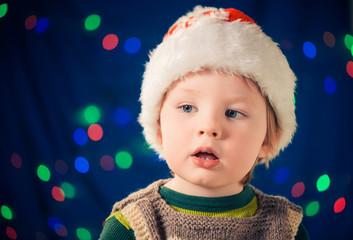 wondering boy in christmas hat