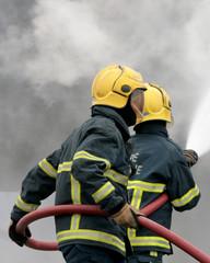 Fire fighters fighting blaze
