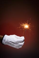 Hand holding sparkler.