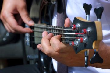 Musician playing bass guitar focus on left hand
