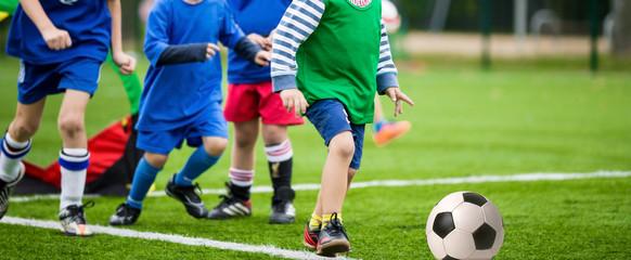 boys kicking football soccer game
