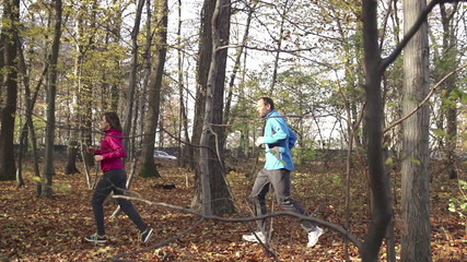 Couple jogging in autumn forest, super slow motion,  240fps