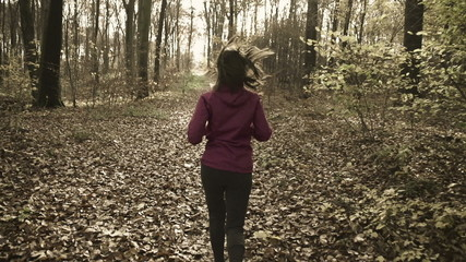 Woman jogging in autumn forest, super slow motion,shot at 240fps