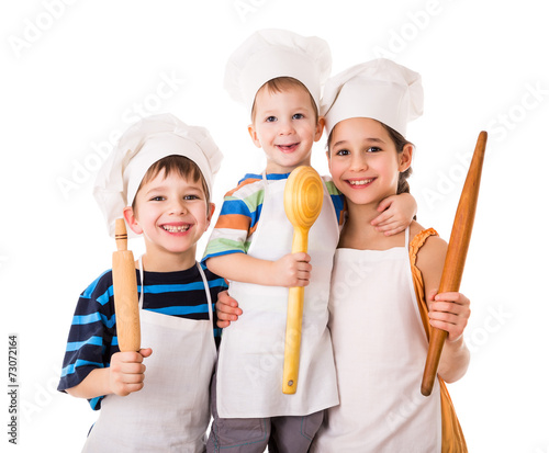 Fotobehang Koken Three young chefs with ladle and rolling pin