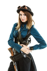 steampunk woman with gun studio shot.
