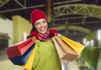 Warmly Dressed Mixed Race Woman with Shopping Bags