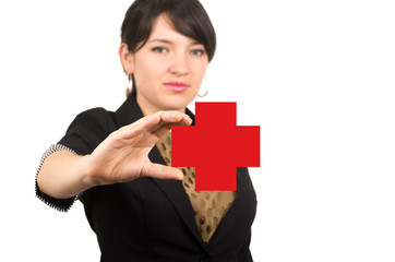 young beautiful girl holding drawn red cross in her hand