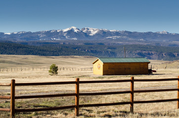 barn in ranch and mountain view