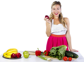 young caucasian female looking at fruits and vegetables