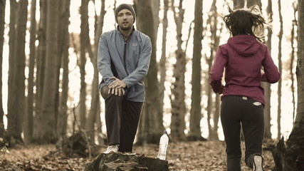 Jogger stretching leg, woman jogging in forest,super slow motion