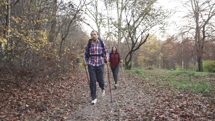 Young couple hiking in autumn forest