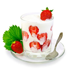 Yogurt thick with strawberries in glass and spoon