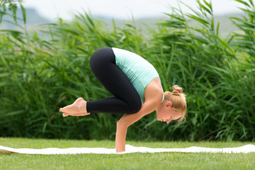 Woman making yoga crow pose