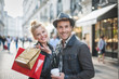 Leinwanddruck Bild - a trendy young couple walks in the city at christmastime, the yo