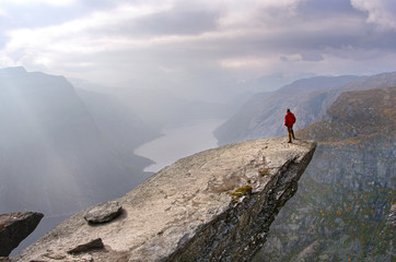 Man in mountains, Trolltunga , Norway