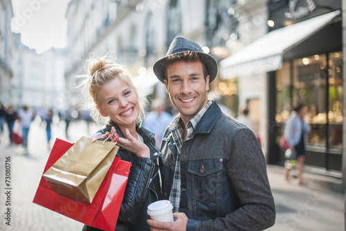 Leinwanddruck Bild a trendy young couple walks in the city at christmastime, the yo