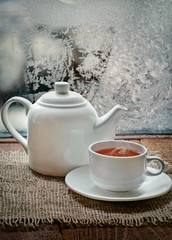 tea cup and  teapot with   in winter frosty day