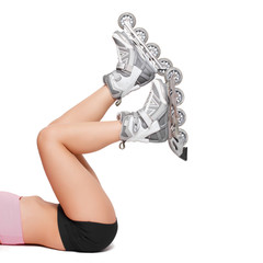 Woman legs with rollerblades