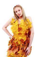 beautiful blonde with blue eyes in dress of leaves