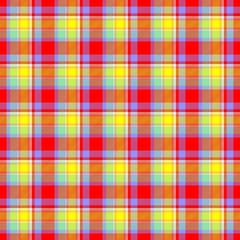 Scottish tartan fabric texture in red and yellow colors.