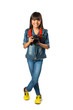 Smiling young asian girl holding photo camera