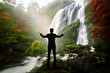 Relaxing businessman standing at waterfall