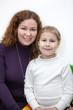 Caucasian mother and preschool daughter portrait