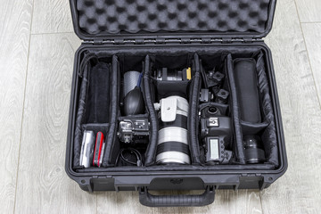 Photo equipments arranged inside of black protector case