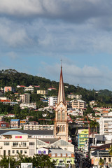 Brown Church Among Colorful Martinique Buildings