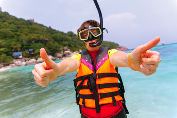 Beautiful young woman with snorkeling equipment