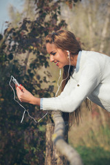 Young beautiful girl listening to music