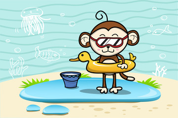 Monkey at the beach with toys