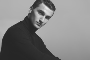 Male beauty concept. Portrait of fashionable young man in black