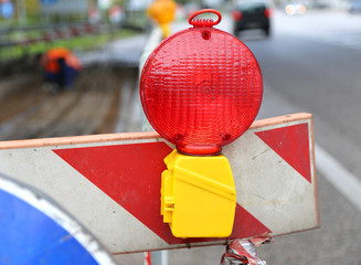 big red lamp to signal roadworks and road works