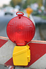 red lamp to signal roadworks and road works in progress