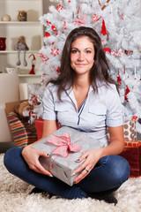 Beautiful woman holding a Christmas present