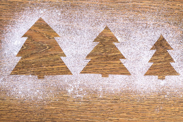 image of a Christmas tree made with flour on the table