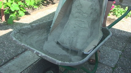 concrete mixes manually with a shovel