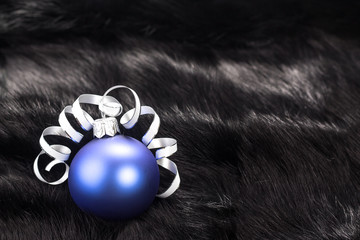 Christmas ball on black fur