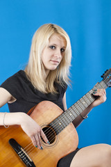 portrait of a young girl with a guitar