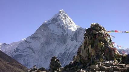 Thamserku Peak and prayer flags Lungta (flying horses). Nepal.