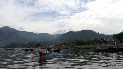 Boats on the Phewa lake in Pokhara. Nepal.