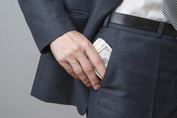 Businessman with money in studio