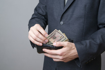 Businessman with money in purse in hands