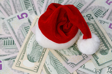 Santa hat on a background of money