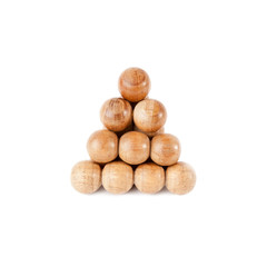 Triangle of wooden balls isolated over white