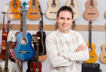 Portrait of a young owner in music shop